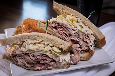 Joe's Deli - Hertel / Colvin, Pastrami, roast beef, and turkey breast with Russian dressing and coleslaw on seedless rye.