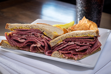 Joe's Deli - 1322 Original, Piled high corned beef or pastrami with mustard on seedless rye.