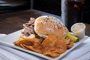 Joe's Deli - Beef on Weck, Slow roasted beef dipped in au jus served on kimmelweck roll with side of horseradish sauce.