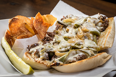 Joe's Deli - Frank Stallone, Chopped steak hoagie with peppers, onions, and melted mozzarella on a hoagie.