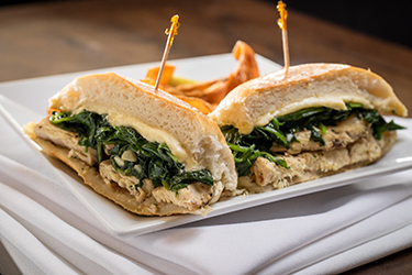Joe's Deli - Grilled Chicken, Chicken breast topped with sautéed spinach and pepper jack cheese on a hard roll.