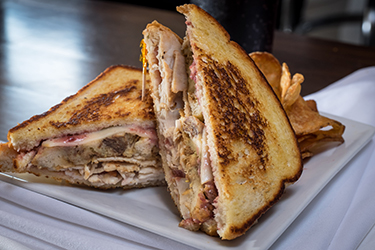 Joe's Deli - I Love Josie, Oven roasted turkey with cranberry mayo, stuffing, and muenster cheese on grilled sourdough.