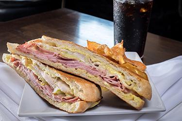 Joe's Deli - Jimmy's Cuban, Marinated pork loin, Sahlen's ham, with lorraine swiss, sliced dill pickles, and honey mustard on grilled ciabatta.