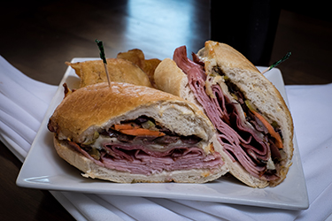 Joe's Deli - Muffuletta, Sahlen's ham, salami, provolone, and fresh homemade olive salad on a French loaf.
