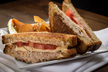 Joe's Deli - Tuna Melt, Tuna with sliced tomatoes and melted pepper jack cheese grilled multi-grain.