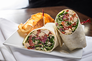 Joe's Deli - Big Mike Wrap, Pesto chicken salad with field greens, sliced almonds, roasted red peppers, pickled onions, and asiago cheese.