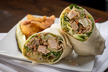 Joe's Deli - Buffalo Turkey Wrap, Sliced turkey breast, shredded lettuce, celery, and carrot tossed in homemade blue cheese dressing with a drizzle of buffalo hot sauce.
