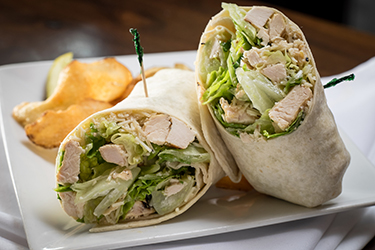 Joe's Deli - Caesar Wrap, Crisp romaine hearts, grilled chicken breast, and shredded asiago cheese tossed in Caesar dressing.