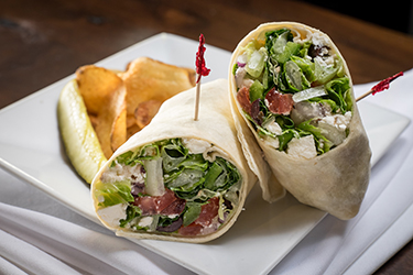 Joe's Deli - Greek Wrap, Romaine mix with kalamata olives, tomato, sliced onion, bell peppers, and feta cheese in Greek vinaigrette.