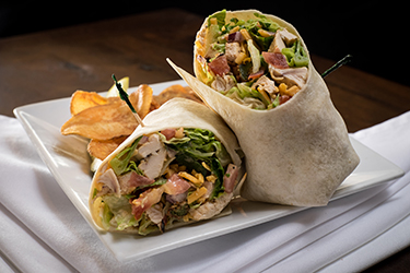 Joe's Deli - Sweet Baby James Wrap, Grilled chicken, crispy avocado, chipotle ranch, romaine, cheddar cheese, red onion, and tomato.