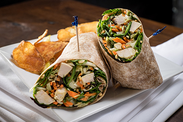 Joe's Deli - Thai Chicken Wrap, Mixed greens with chicken, carrots, scallions, shredded cabbage and crushed peanuts in an Asian vinaigrette.